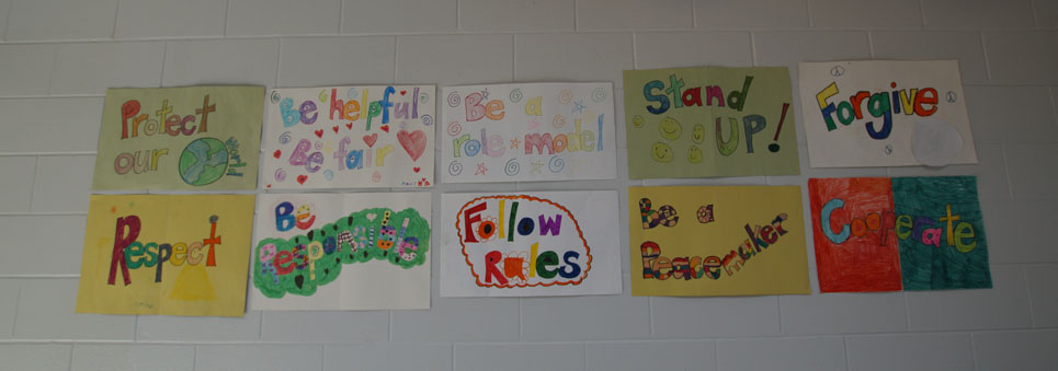 Artwork on a wall promoting respect, kindness, helping others, code of conduct