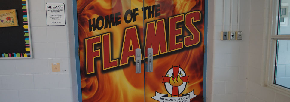 Doors to the gym saying Home of the Flames